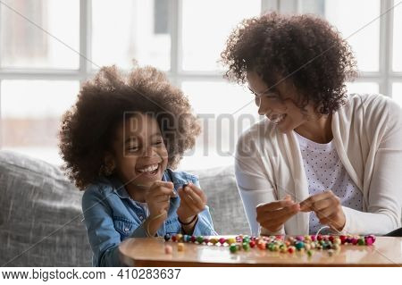 Happy Excited Black Mother And Daughter Kids Sharing Craft Hobby