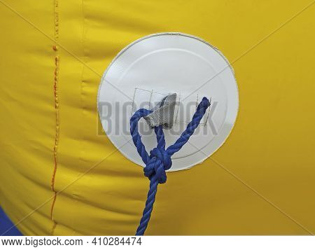 Yellow Buoy Texture With Blue Rope And Nautical Knot Called
