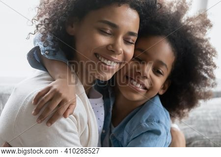 Happy African American Girl Embracing Her Peaceful Mom