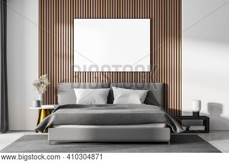 White Bedroom Interior With Concrete Floor, A Gray Bed And Two Bedside Tables. A Cabinet With Mirror