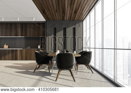 Grey Dining Room With City View On Skyscrapers. Dining Table With Dishes And Six Chairs. Kitchen Set