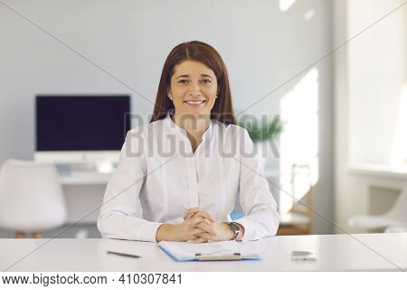 Smiling Business Woman Or Office Worker Looking At Camera During Online Videocall Or Interview
