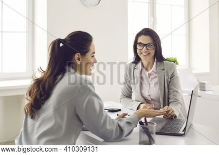 Happy Business Woman Consulting Insurer, Bank Manager, Loan Broker Or Real Estate Agent