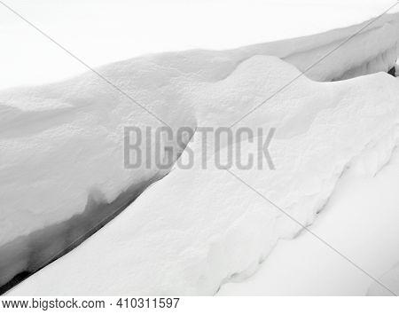 Snow Drift. Deep Snow Drifts In The Winter. Snow Drift Sculpted By Strong Winter Blizzard.