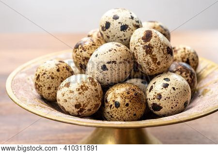 Fresh Small Spotted Partridge Eggs On Bronze Plate
