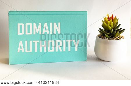 Domain Authority, The Text Is Written On A Green Notepad And A White Background, Next To A Cactus Fl