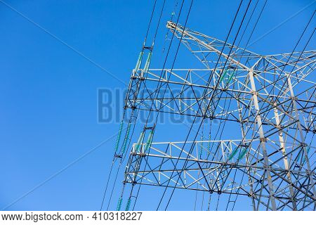 New Large Mast Of An Air Power Line Close Up, High Voltage Electricity Pylon With Thick Wires And In