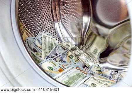 Launder Money. Washing Machine And Dollars. Money And Washing Machine Tank. Concept: Tax Evasion