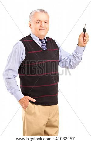 Satisfied mature man holding a car key isolated on white background