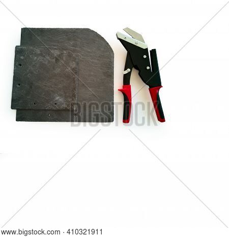 New Professional Tool, Slate Cutter, Black With Red Handles, Isolated On White Background, And Sheet