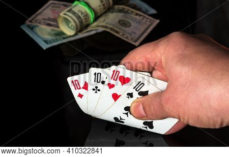 Poker Cards With Four Of Kind Or Quads Combination. Close Up Of A Gambler Hand Is Holding Playing Ca