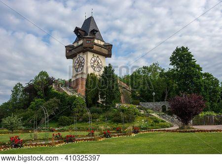 The Famous Clock Tower (grazer Uhrturm) And Gardens On Schlossberg Hill, Graz, Styria Region, Austri