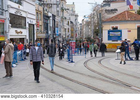 Beyoglu, Istanbul, Turkey - 02.17.2021: Starting Point Of Istiklal Street In Taksim And Tram Way On