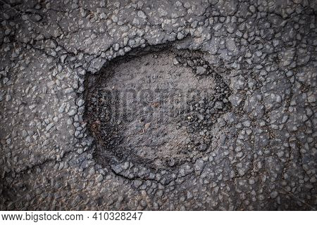 A Dangerous Pothole In A City Street, From Above