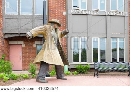 NAPERVILLE, ILLINOIS - MAY 26, 2017: Dick Tracy Statue. Located along the city River Walk at the Naperville Township Building. Town resident Dick Locher became illustrator of the strip in 1983.