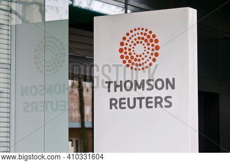 Zug, Switzerland - 26th February 2021 : Thomson Reuters Sign Hanging In Front Of The Office Entrance