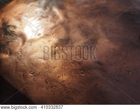 Metal Bronze Textured Plate. Bronze Or Copper Polished Surface With Dents, Scratches And Indentation
