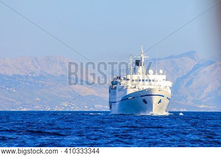 Split, Croatia - Janury 1, 2000: View Of A Ferryboat With Mountains Over Split In The Background