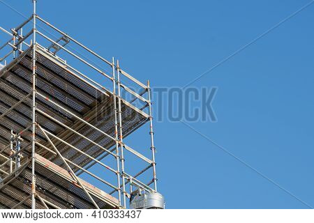 Construction Scaffolding Against A Clear Blue Sky. Copy Space.