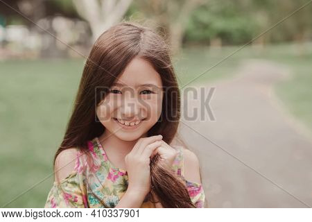 Close Up Urban Lifestyle Portrait Of A Confident, Charming And Gorgeous Mixed Race Child Face, Happy