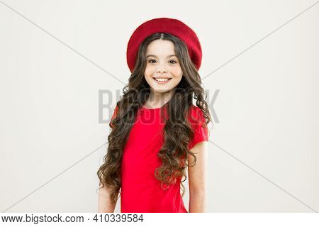 Parisian Child On Yellow Background. Little Girl In French Style Hat. Childhood. Hairdresser Salon.
