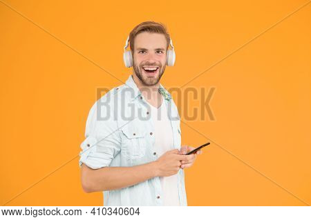 Man Listen Music Modern Headphones And Smartphone. Listen For Free. Get Music Family Subscription. E