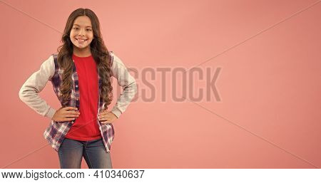 Teen Promoting Fashion Clothes. Kids Fashion. Smiling School Girl. Kid Long Curly Hair. Small Girl W