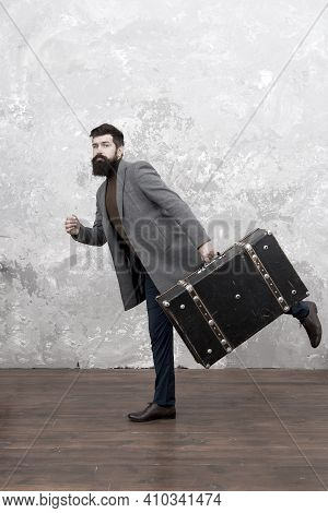 Travel And Baggage Concept. Hipster Traveler With Baggage. Ready For Relocation With Baggage. Start