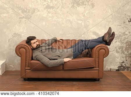 Looking Good And Staying In Fashion. Brutal Hipster Relax On Sofa. Bearded Man With Fashion Look. Me