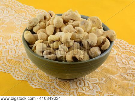 Brazilian Sweet Kettle Corn Popcorn In Ceramic Snack Bowl On White Lace Table Runner On Yellow Table