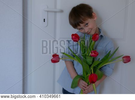 Flowers For Your Beloved Mother. Boy Holding A Bouquet Of Tulips. Mothers Day