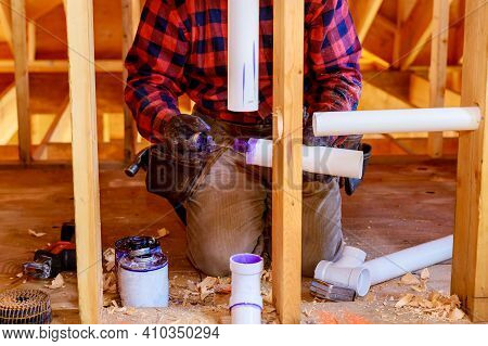 Plumbing Building Contractor Installing Plastic Drain Pipe In The Elbow For Sink Drain For A Custom