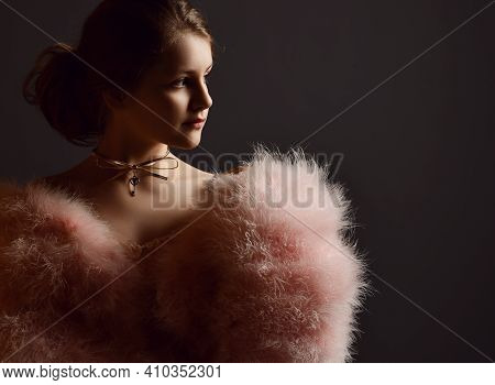 Portrait Of Royal Kid Girl Theatre Actress In Clothes With Big Furry Sleeves And Gold Necklace Looki