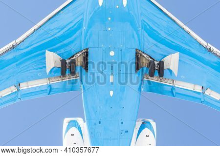 View From Below Under The Flying Airplane Before Landing, In Detail Chassis, Wings, Flaps, Fuselage
