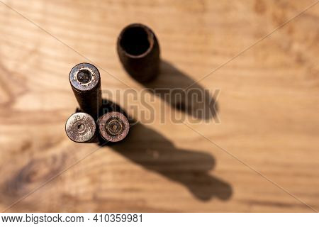 Old Rusty Artillery Shell And Aircraft Projectile On Wooden Background, Shells Bullets Of World War