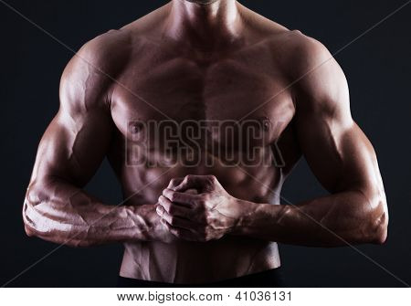 Muscular male torso with lights showing muscle detail isolated