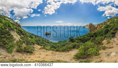 Yachts In The Sea On A Background Of Rocky Shores. Sea Landscape With Yachts And Rocky Coastline. Co
