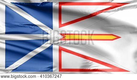 Flag Of Newfoundland And Labrador.the Blue Represents The Waters Of The Sea, Lakes And Rivers; The W