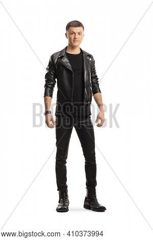Full length portrait of a teenage male in leather jacket and pants posing isolated on white background