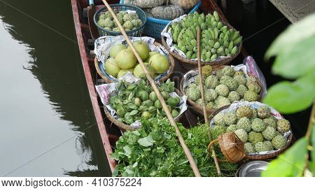 Iconic Asian Lat Mayom Floating Market. Khlong River Canal, Long-tail Boat With Tropical Exotic Colo