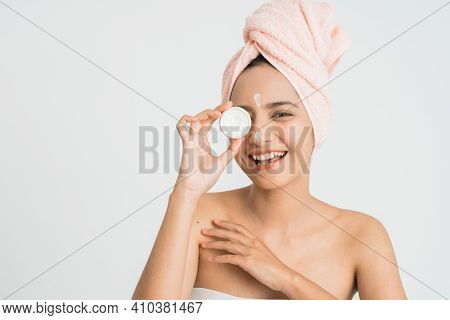 Beauty Asian Woman Put Cosmetic Cream On Her Face