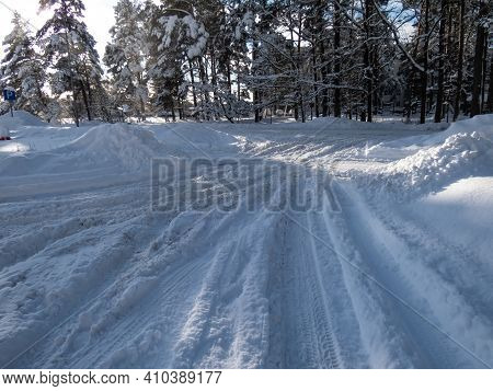 Dangerous And Slippery Road Conditions. Road Covered With A Lot Of Snow After Heavy Snow Storm. Accu