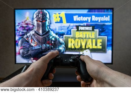 Playing Video Game. Gaming Fortnite On Playstation 4