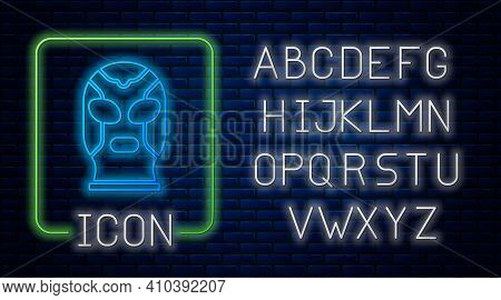 Glowing Neon Mexican Wrestler Icon Isolated On Brick Wall Background. Neon Light Alphabet. Vector