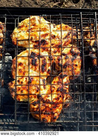 Grilling Chicken Meat On The Barbecue Charcoal Grill