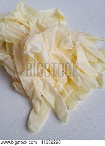 Pile Of White Medical Gloves On White Background