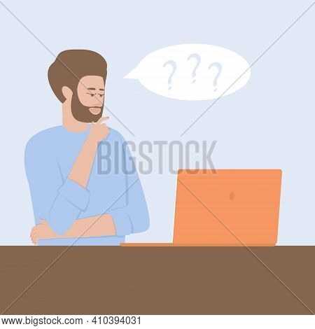 A Man At A Laptop In Doubt About Making A Decision. Pensive Concept. Determination Of The Correct Di