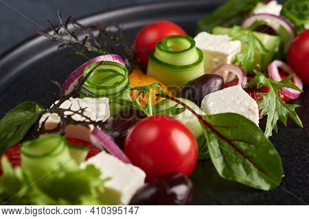 Fresh Greek Salad With Tomato, Cucumber, Bel Pepper , Olives And Feta Cheese On Black Plate, Macro,