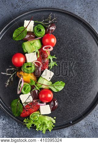 Fresh Greek Salad With Tomato, Cucumber, Bel Pepper , Olives And Feta Cheese On Black Plate, Vertica