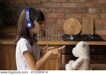 Small Latino Girl Child Listen To Music In Headphones